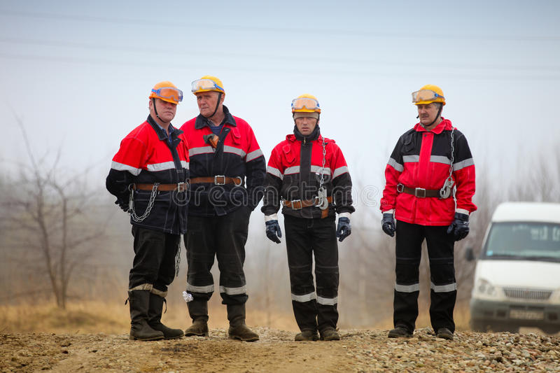 Gas oil production operator works and maintains well site stock images