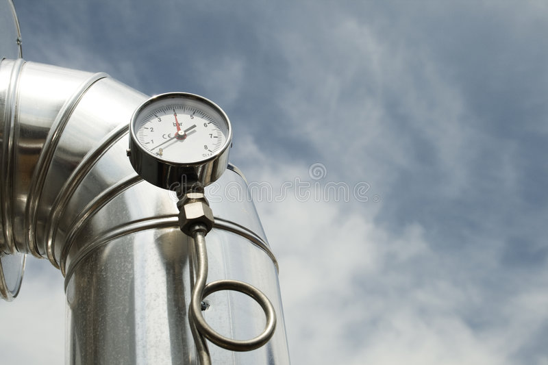 Gas pressure Manometer. A manometer that indicates gas pressure inside the pipeline - sky and clouds on the background recall the main object stock images