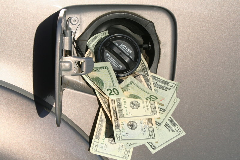 Gas Prices. Gas tank closed with money spewing out from the lid stock photography