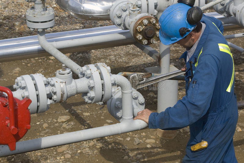 Gas Production Operator. Maintains well site stock images