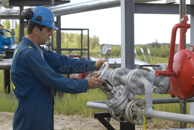 Gas Production Operator. Maintains well site royalty free stock image