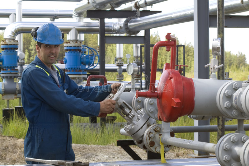 Gas Production Operator. Maintains well site stock photo
