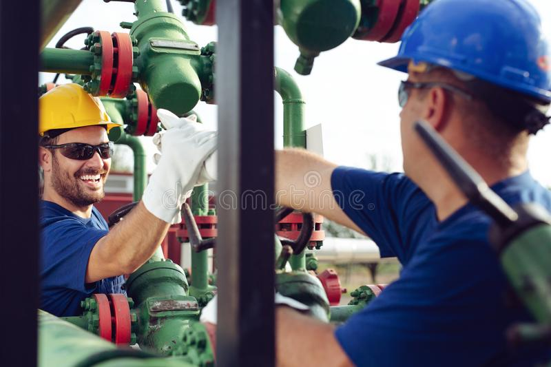 Gas Production Operators. Two young Gas Production Operators royalty free stock photos