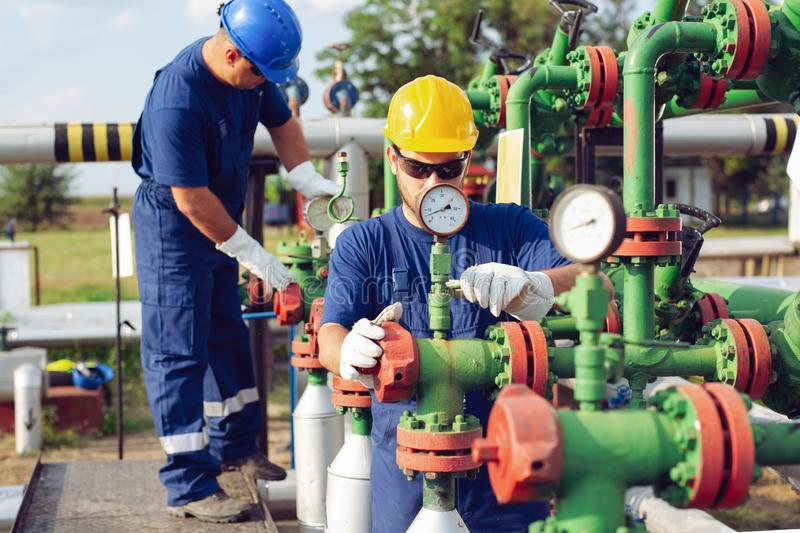 Gas Production Operators. Two young Gas Production Operators royalty free stock photography
