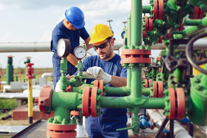 Gas Production Operators. Two young Gas Production Operators stock photos