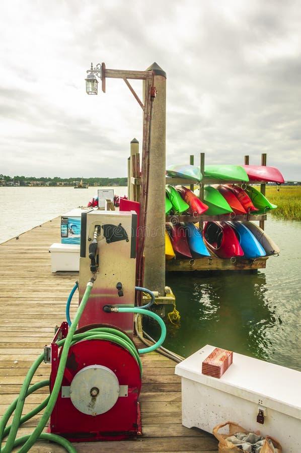 Gas pump at Hilton Head Island dock. Near the kayak storage stock images