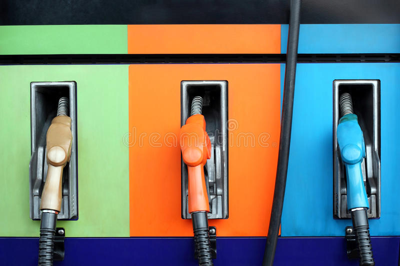 Gas pump nozzles. On service station royalty free stock photography