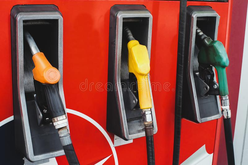 Gas pump nozzles in a gas station stock photos