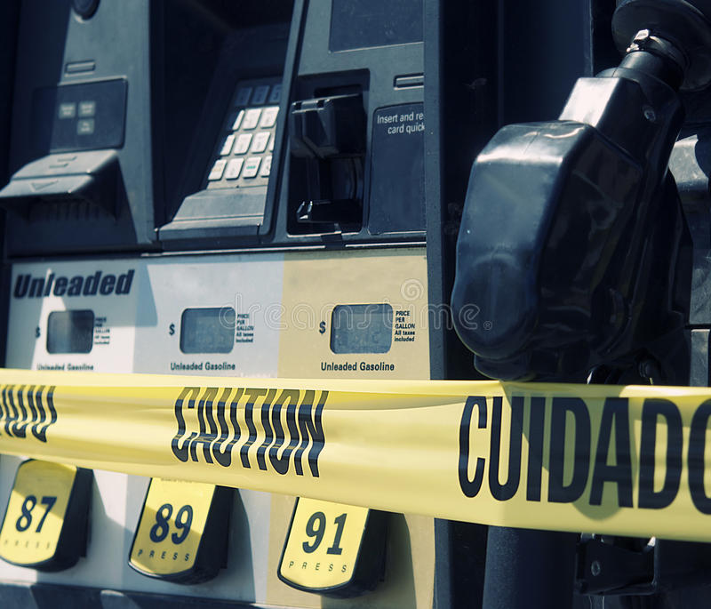 Download Gas Pump At Station With Caution Sign Stock Image - Image: 21265589