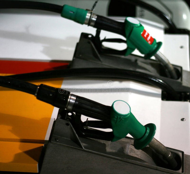 Gas pumps at a gas station stock photography