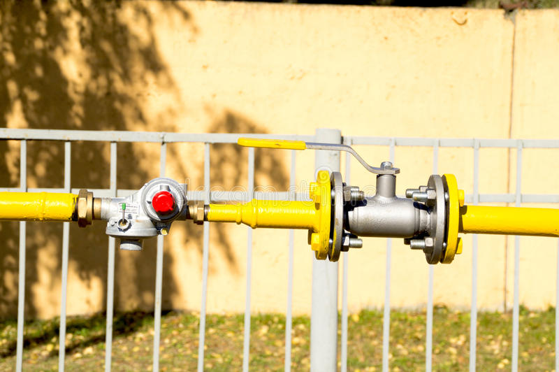 Gas reducer and the valve on the pipeline stock photography