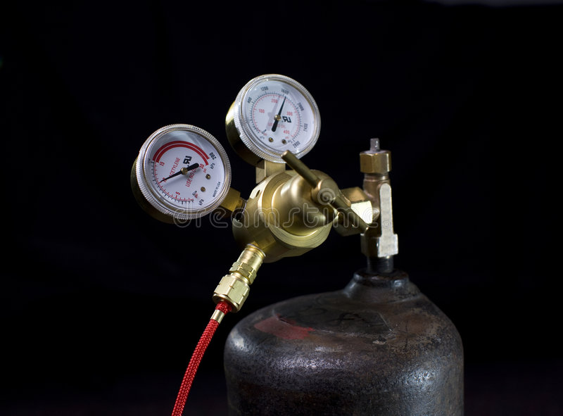 Gas regulator. Acetylene tank, welding tools royalty free stock image