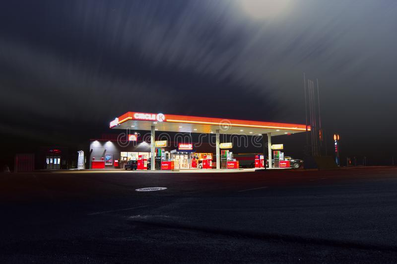 Gas station illuminated at night royalty free stock image