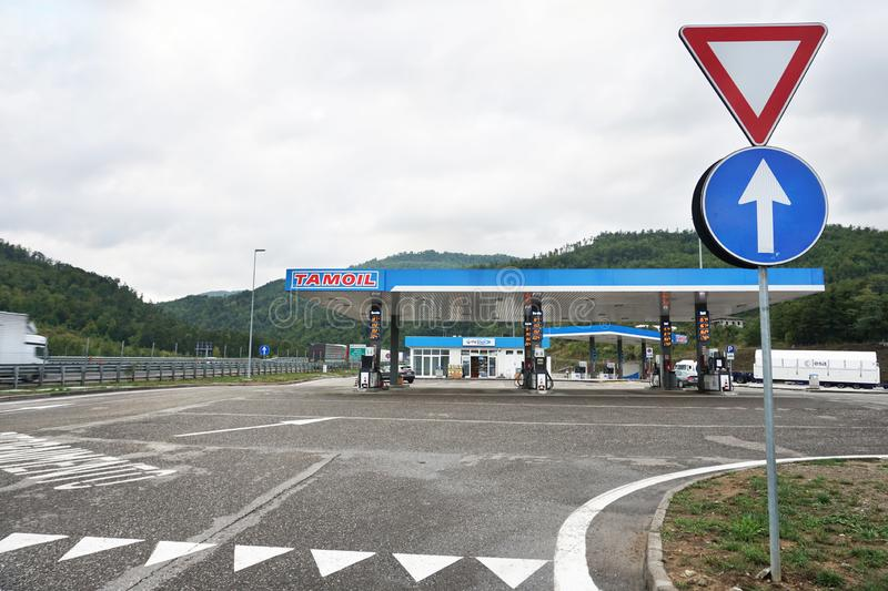 A gas station near the highway stock image
