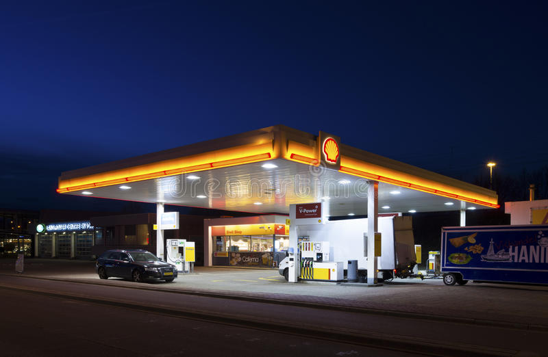 Gas station at night stock image