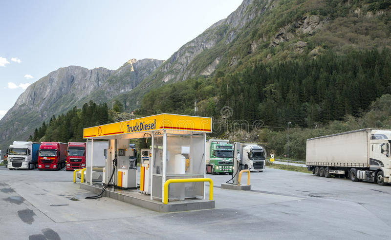Gas station. With trucks parked next to the mountains of southern Norway on a sunny day. It`s an editorial image stock photos