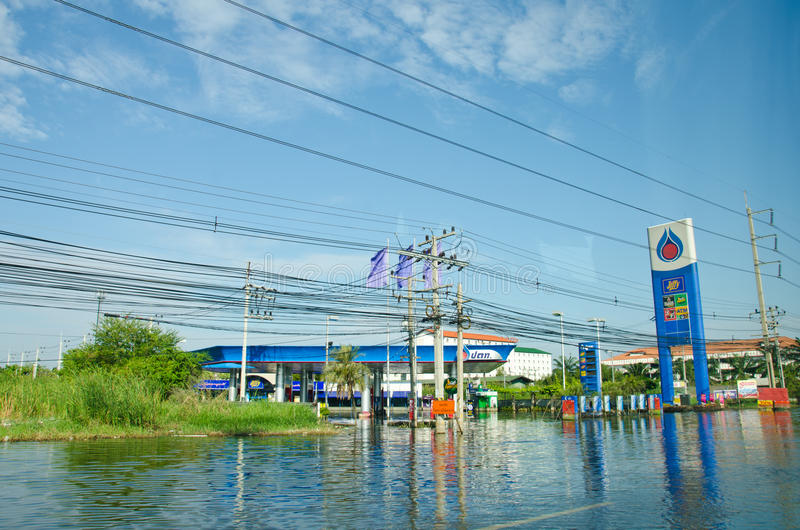 Gas stations during its worst flooding. PATHUM THANI THAILAND – NOVEMBER 14: Gas station in Pathum Thani during its worst flooding in decades is a major royalty free stock photo