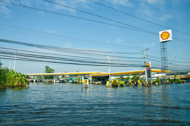 Gas stations during its worst flooding. PATHUM THANI THAILAND – NOVEMBER 14: Gas station in Pathum Thani during its worst flooding in decades is a major stock photography