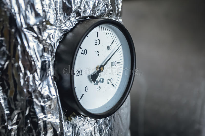 Gas or steam leaking from an industrial pressure gauge. royalty free stock photos