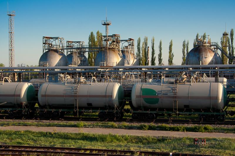 Gas storage sphere tanks and train tanks in petrochemical factory royalty free stock image