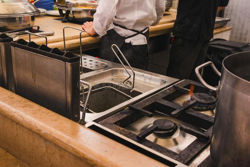Gas stove and deep fryer in the kitchen stock photo