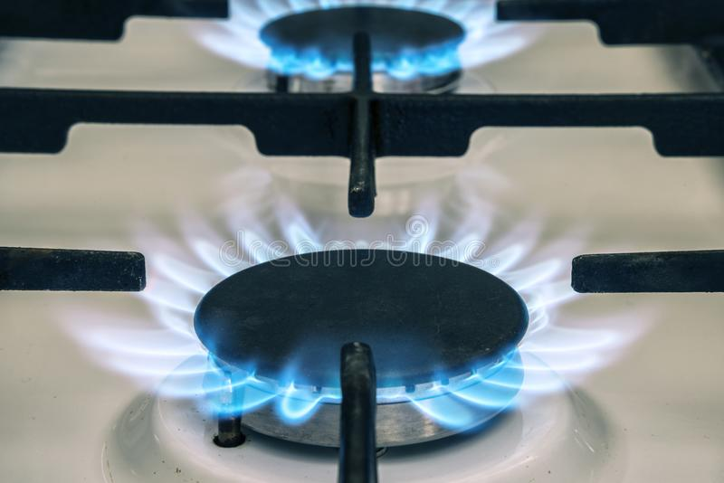 Gas stove flame on kitchen. Blue fire flame from stove royalty free stock image