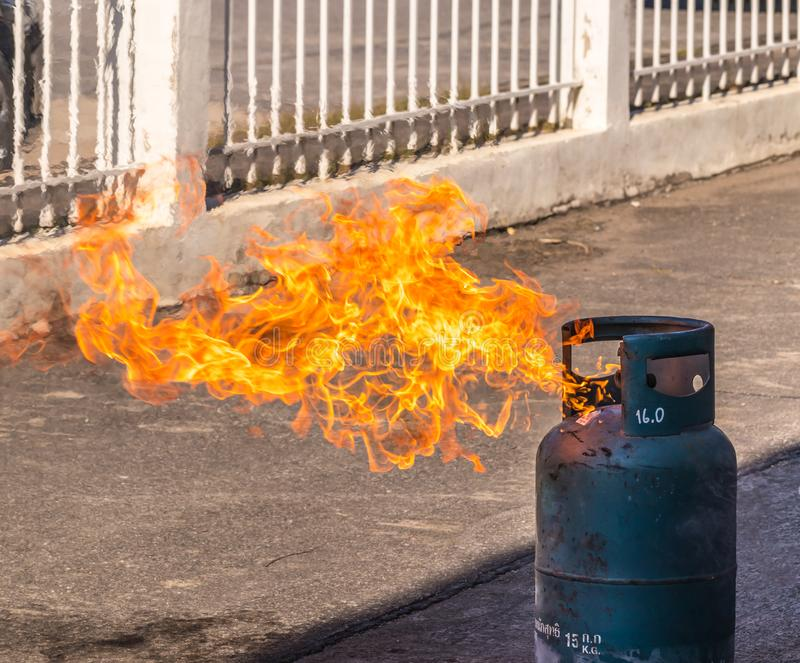 Gas tank with a burning flame stock image