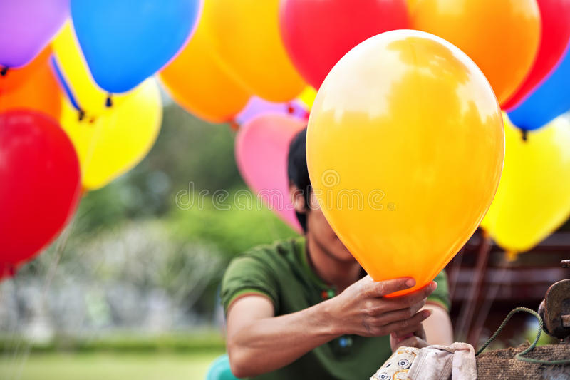Gas to balloon. Hand Compressing gas to balloon royalty free stock photos