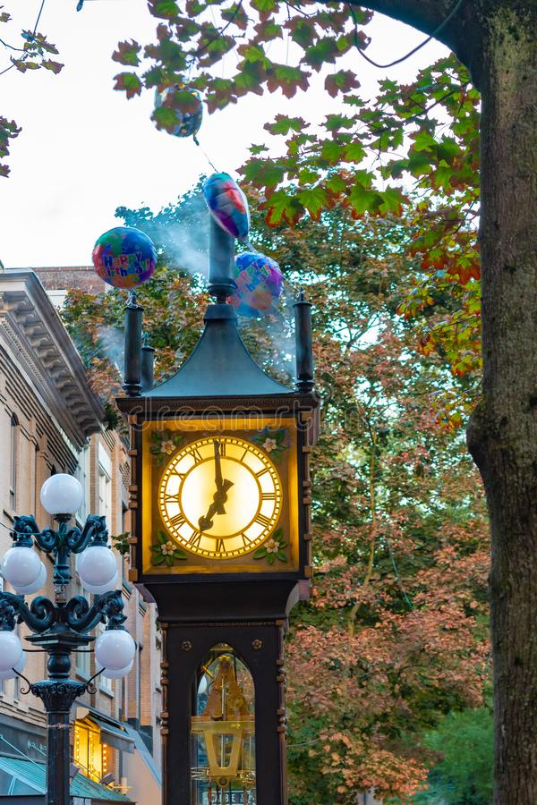 Gas Town Steam Clock in Gastown, Vancouver. Historical Gas Town Steam Clock at 7pm on an autumn evening in Gastown, downtown Vancouver, Canada stock photo