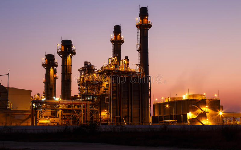 Gas turbine electrical power plant at dusk. With light royalty free stock image