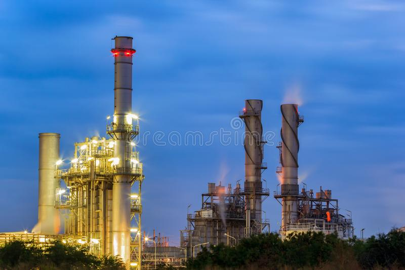 Gas turbine electrical power plant at dusk with twilight support all factory in industrial Estate. Gas turbine electrical power plant at dusk with twilight stock image