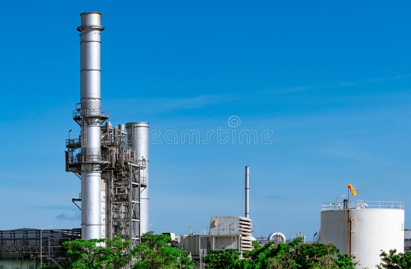 Gas turbine electrical power plant. Energy for support factory in industrial estate. Natural gas tank. Small gas power plant. stock image