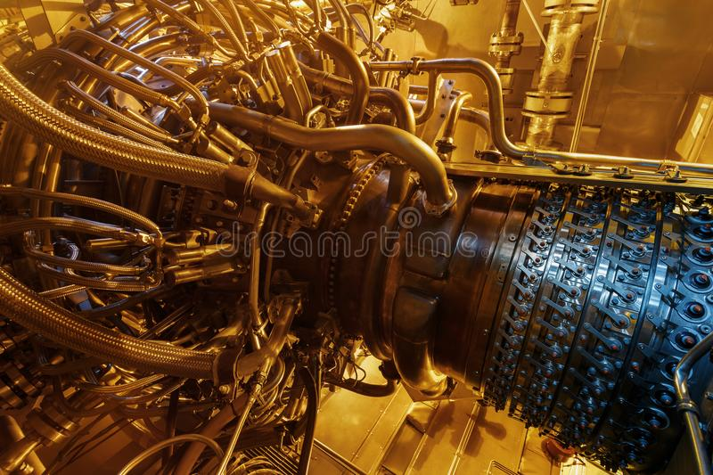 Gas turbine engine of feed gas compressor located inside pressurized enclosure, The gas turbine engine used in offshore. Oil and gas central processing platform stock photo