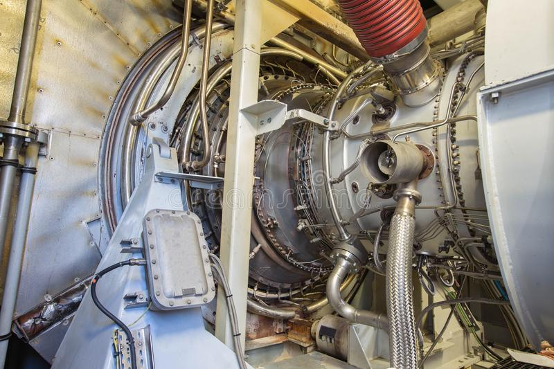Gas turbine engine of feed gas compressor inside enclosure. royalty free stock image