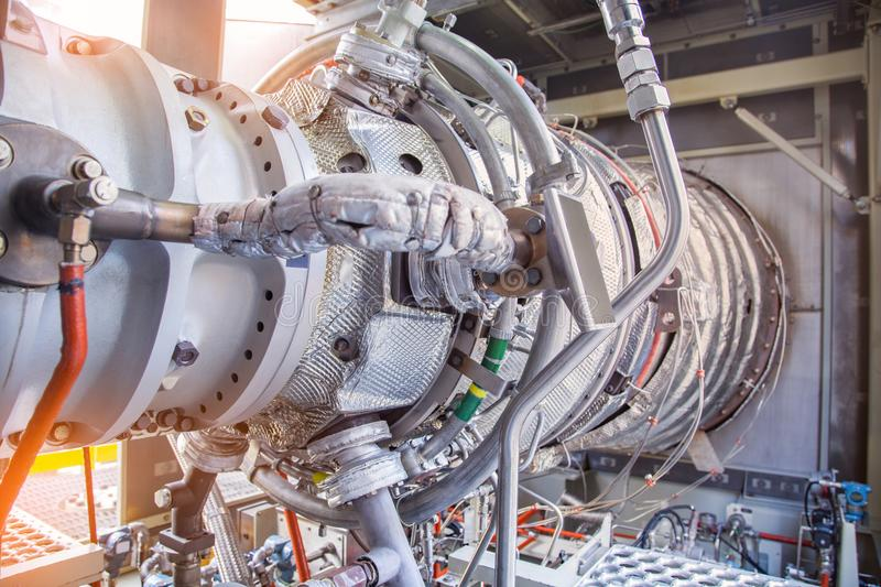 Gas turbine engine inside enclosure installed at oil and gas platform. stock images