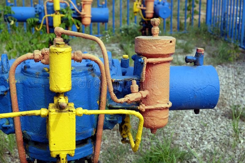Gas unit with faucet and other energy equipment after fence at rural place royalty free stock photo
