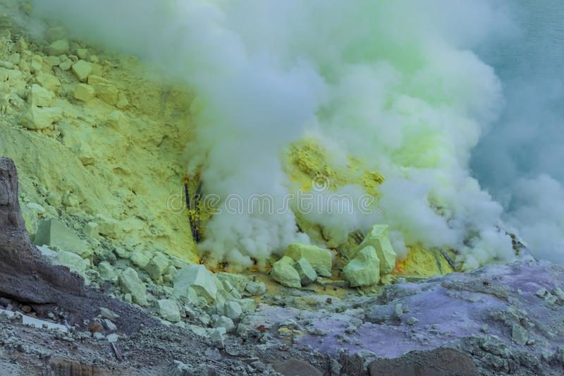 Gas from volcanic vent, Mount Ijen, East Java, Indoensia. Yellow sulphur on crater wall behind. stock image
