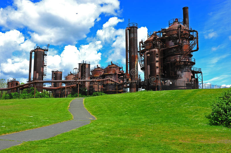 Gas works plant. Path leads up to an old abandoned gas works plant located at gas works park in Seattle Wa stock images