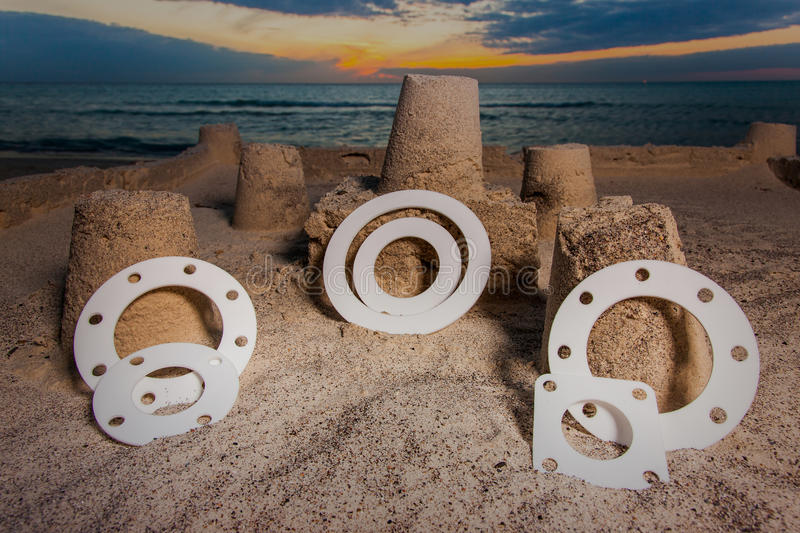Gasket and flanges. Gasket, mechanical seal which fills the space between two or blackberries mating surfaces, to prevent leakage of objects while under stock image