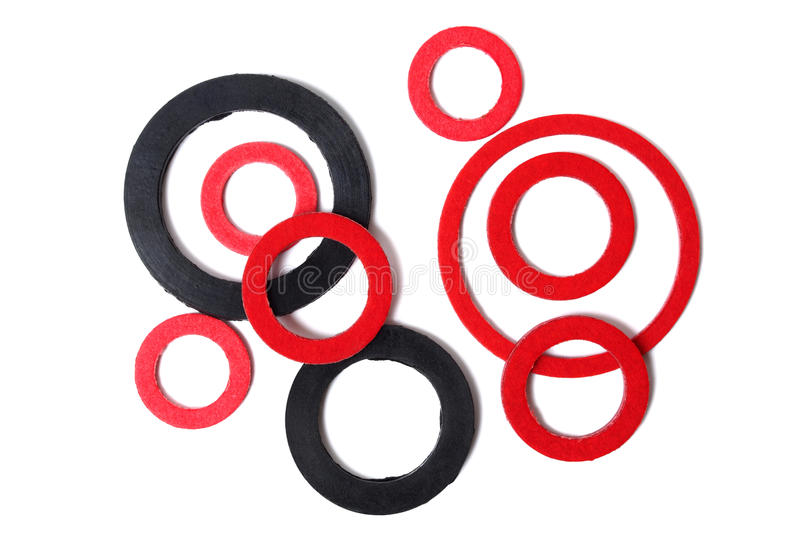 Gaskets. Macro of red and black gaskets isolated on white background stock photos