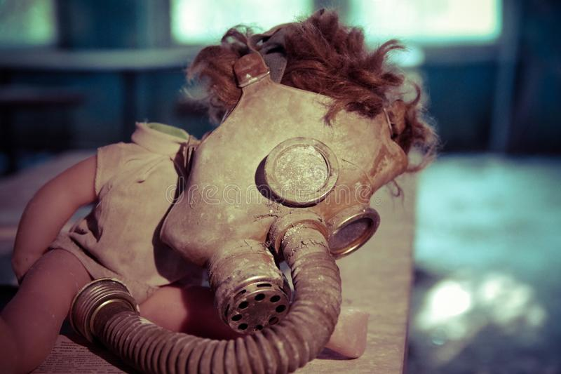 Gasmask on a doll in the school of Pripyat, Chernobyl zone stock images