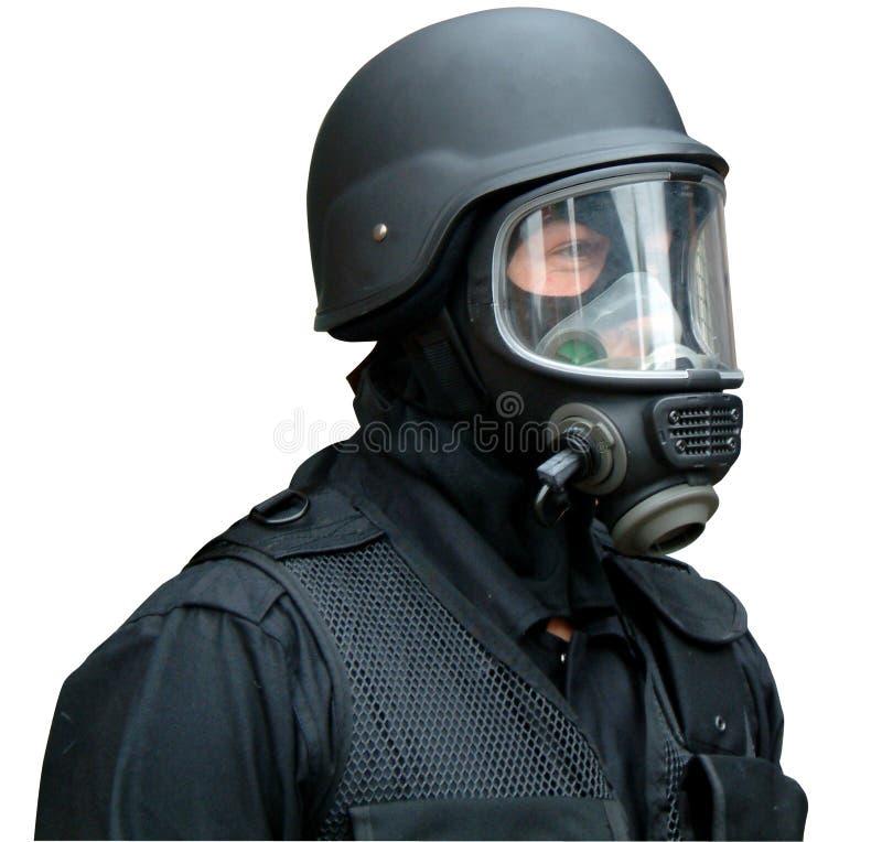 Gasmasker en helm stock afbeelding