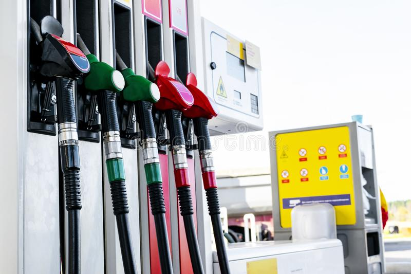 Gasoline and diesel distributor at the gas station. Gas pump nozzles. Petrol filling gun close-up at the gas station. Colorful Pet royalty free stock photos
