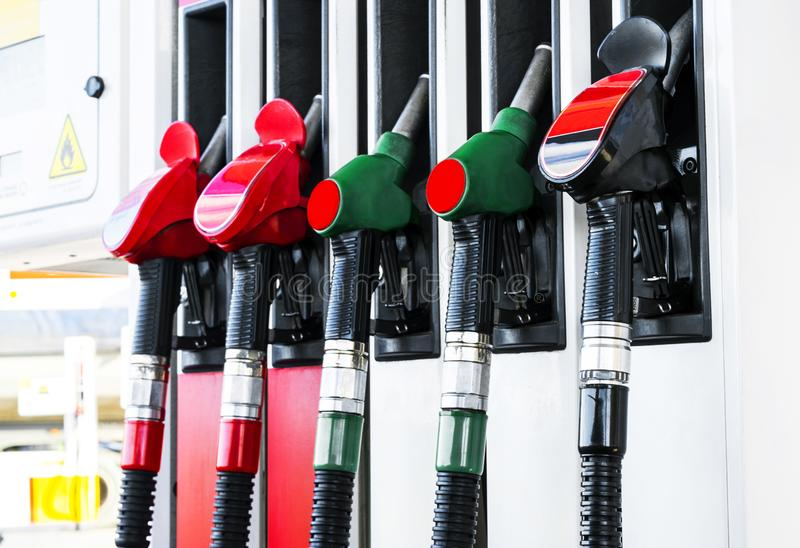 Gasoline and diesel distributor at the gas station. Gas pump nozzles. Petrol filling gun close-up at the gas station. Colorful Pet royalty free stock images
