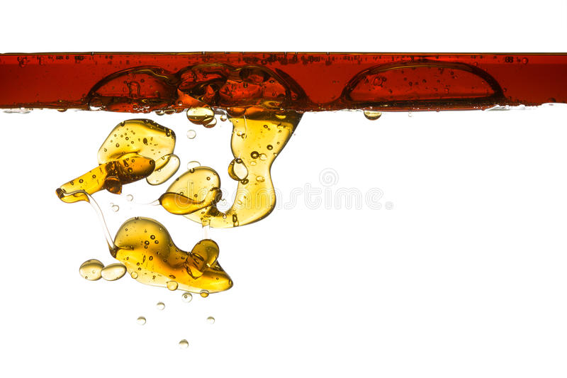 Gasoline isolated in water (white). Pollution, environment concept royalty free stock photo