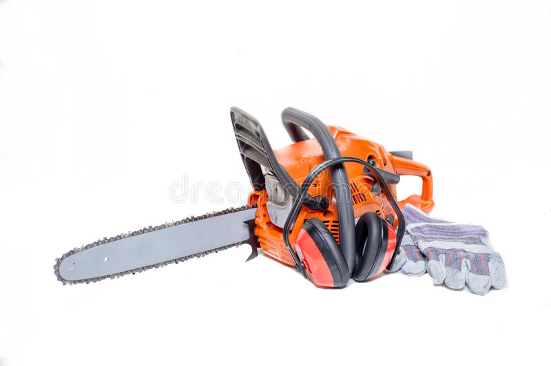 Gasoline powered modern chainsaw with protective gear. Gasoline powered chainsaw with protective gear and accesories isolated on white background stock photography