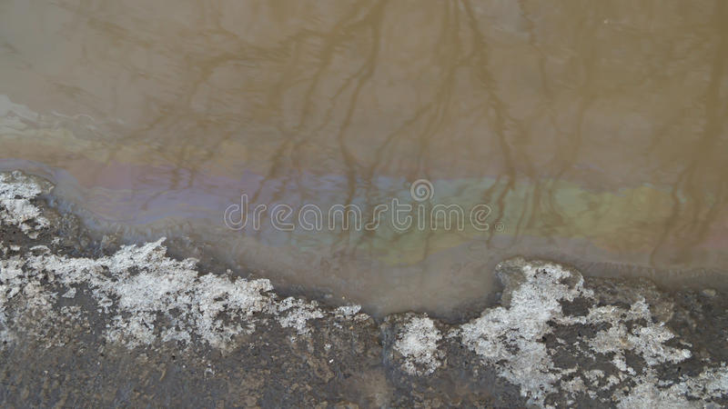 Gasoline on the surface of water royalty free stock photography