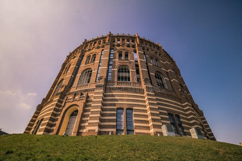 The Vienna Gasometer on sunny day in Vienna, Austria. The gasometers in Vienna-Simmering are four former gas tanks preserved in the facade. They have been royalty free stock image