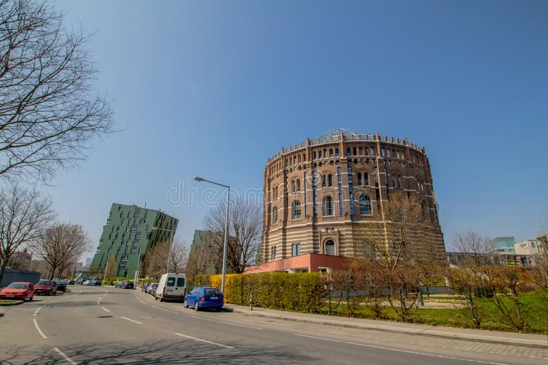 The Vienna Gasometer on sunny day in Vienna, Austria. The gasometers in Vienna-Simmering are four former gas tanks preserved in the facade. They have been stock photography