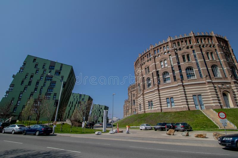 The Vienna Gasometer on sunny day in Vienna, Austria. The gasometers in Vienna-Simmering are four former gas tanks preserved in the facade. They have been stock image